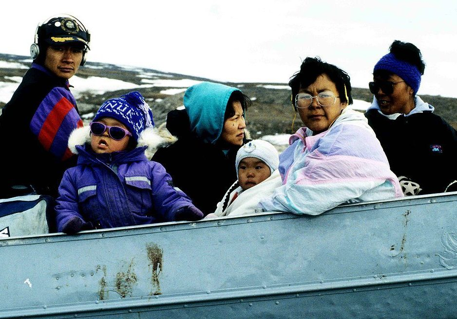 Inuit travelling in a boat on a qamutiq (sled) near Pond Inlet (Nunavut Territory, Canada). (Photo credit: Ansgar Walk/Wikimedia Commons.)