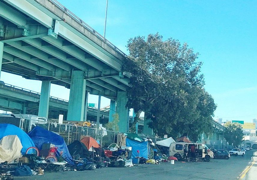 Tents used by homeless people in San Francisco under a freeway overpass. (Photo credit: Shannon Badiee/Wikimedia Commons)