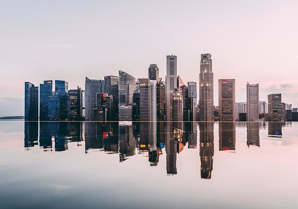 "Singapore skyline. (Photo credit: <a href=""https://www.reddit.com/r/singapore/comments/7w3yvr/singapores_skyline_during_sunset/"" target=""_BLANK"" rel=""noopener noreferrer"">xPhantomhive</a>/Wikimedia Commons)"