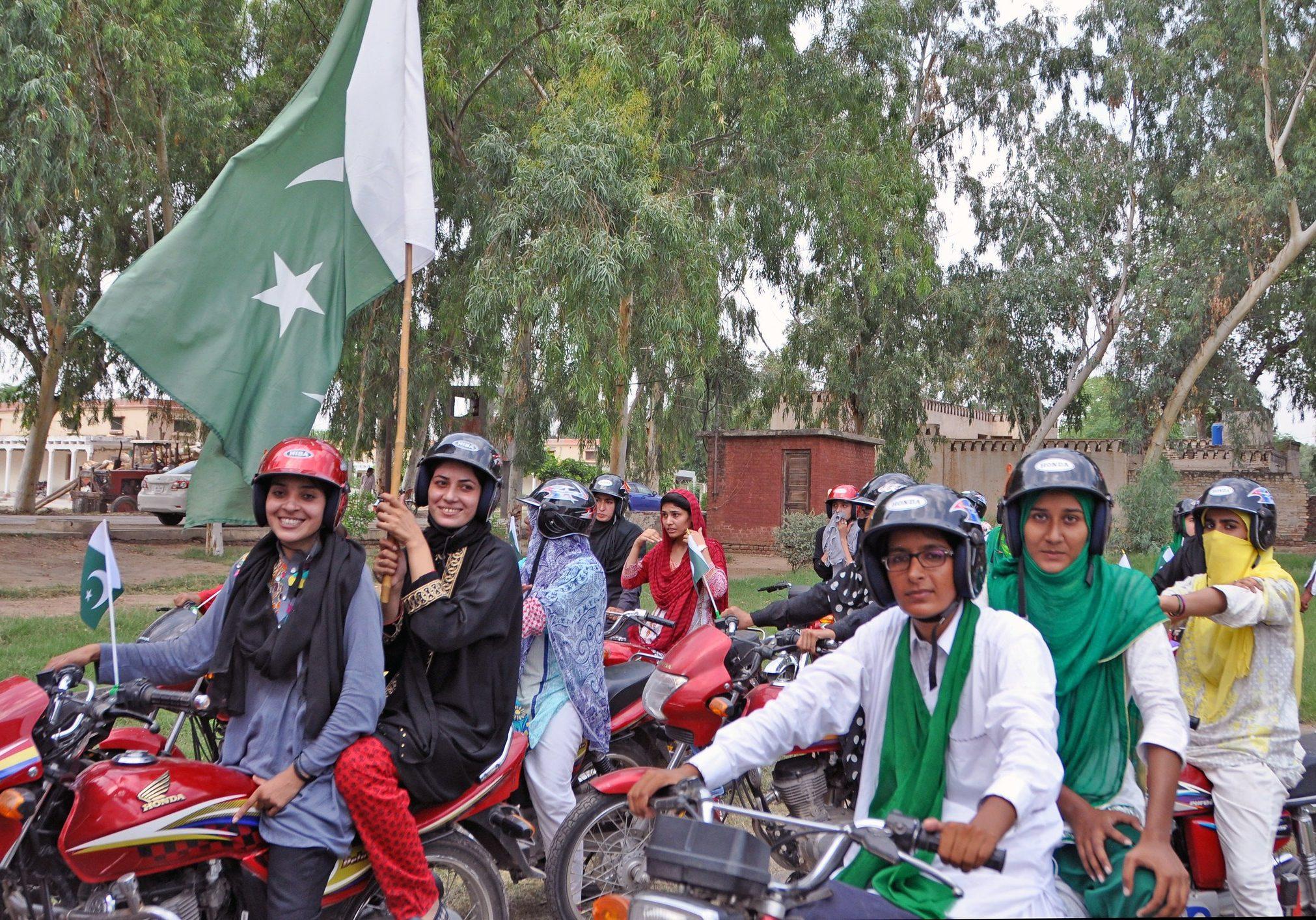 Riders at the Women on Wheels launch in Pakistan in 2016. (Photo: UN Women/Henriette Bjoerge)