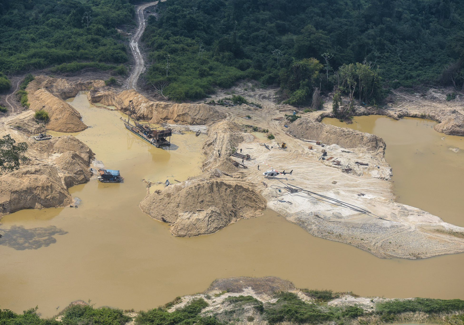In this 2017 photo, Brazilian environmental police conduct an interdiction on an illegal gold-mining operation on Kayapó indigenous land in the Amazon rainforest. Under the current presidency of Jair Bolsonaro, industrial incursions into the Amazon are expected to increase, leading the Kayapó to make peace with traditional enemies and present a united front against further resource development. Photo credit: Felipe Werneck/Ibama