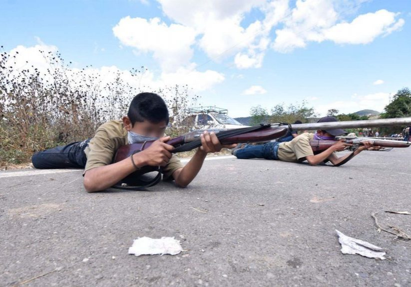 Gerardo, 15, and Gustavo, 13, abandoned their studies to join a local militia formed to defend their town against a violent criminal gang. (Photo credit: Cuartoscuro)