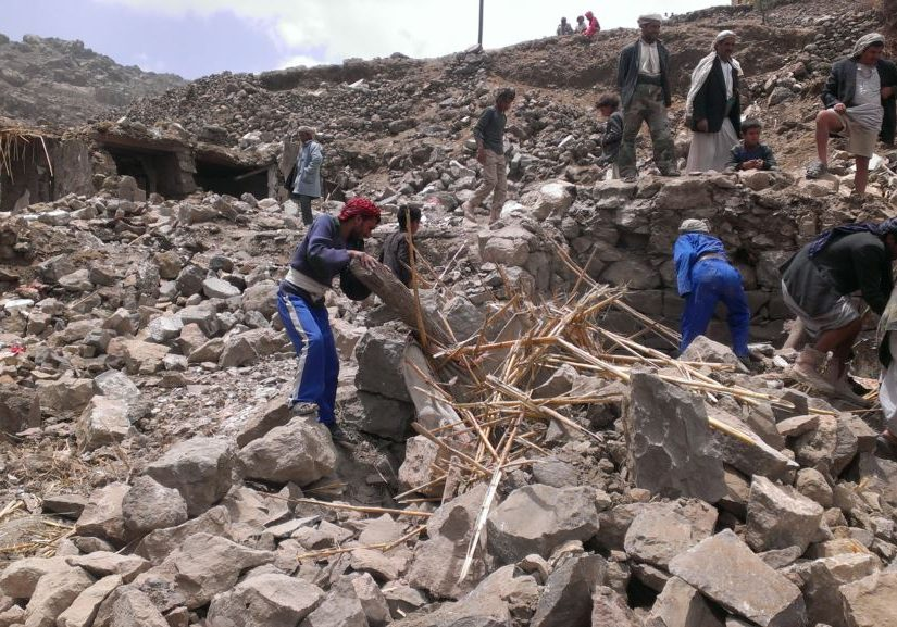 Villagers scour rubble for belongings scattered during the bombing of Hajar Aukaish in Yemen in 2015. Photo source: Voice of America/Wikimedia Commons.