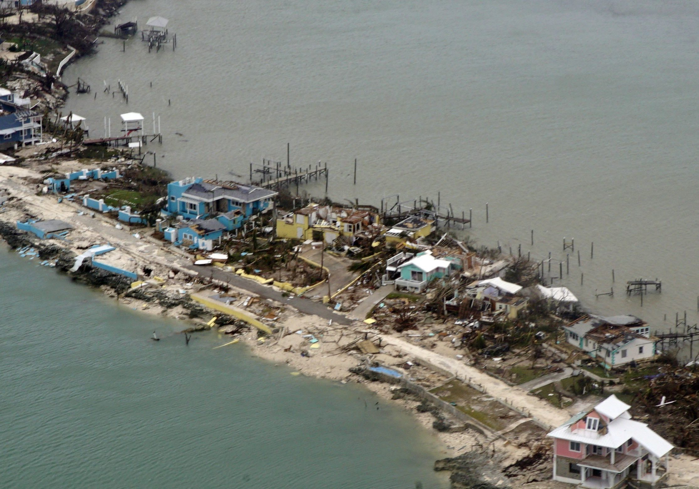 Overhead view of a row of damaged structures in the Bahamas from a Coast Guard Elizabeth City C-130 aircraft after Hurricane Dorian shifts north Sept. 3, 2019. Hurricane Dorian made landfall Saturday and intensified into Sunday. U.S. Coast Guard photo by Petty Officer 2nd Class Adam Stanton.
